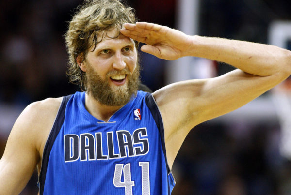 Dallas Mavericks power forward Dirk Nowitzki (41) celebrates after scoring his 25,000 career point during the first half of an NBA basketball game against the New Orleans Hornets in New Orleans, Sunday, April 14, 2013. (AP Photo/Jonathan Bachman)